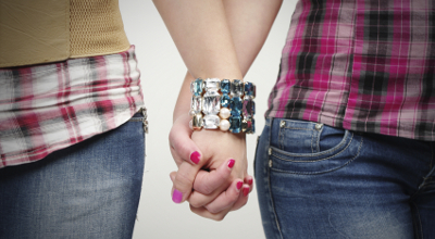 2 women holding hands