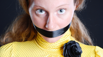 Woman mouth taped shut