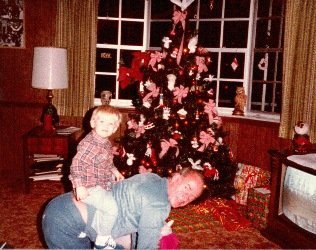 Jamie Buckingham let his young grandson, Timothy Jamie Buckingham (T.J.), ride on his back during Christmastime